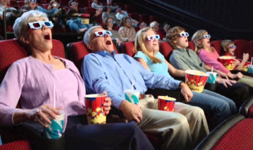 İzleyiciler 3D bir film izlerken.